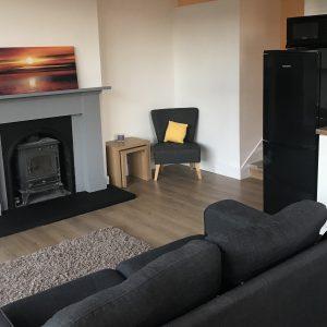 Lounge - cosy wood burning stove