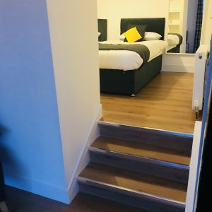 Steps from lounge/kitchenette to bedroom