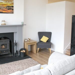Lounge fireplace, wood burning stove and seating